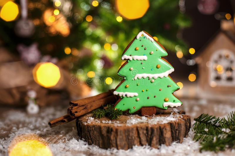 Holiday traditional food bakery. Gingerbread green christmas tree in cozy warm decoration with garland lights.  royalty free stock image