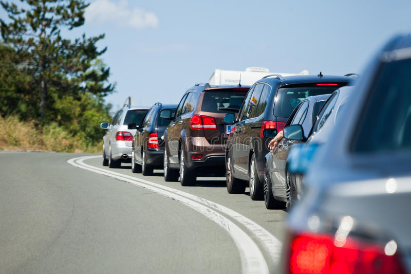 Holiday traffic jam. Standing cars in a holiday traffic jam stock image