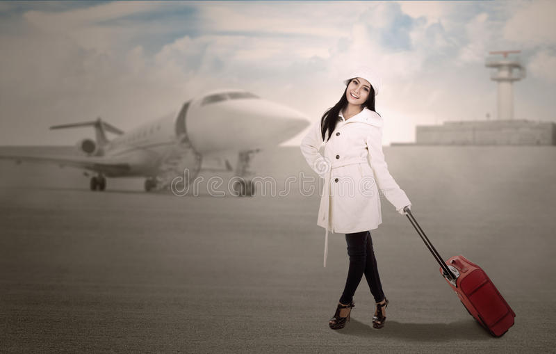 Download Holiday Travel At Airport In Winter Stock Photo - Image of businesswoman, adult: 27818934
