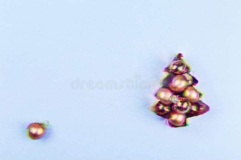 Holiday tree copper cookie cutter full of rose gold rounds on blue background. Holiday, Christmas and New Year concept. Cozy homey stock image