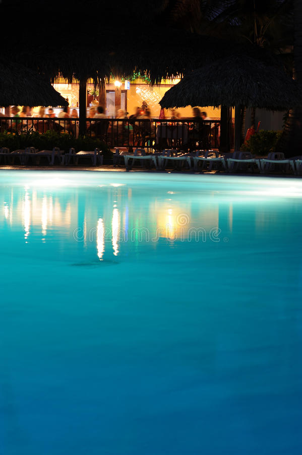 Download Holiday Vacation Resort Pool Bar At Night Stock Photos - Image: 12551683