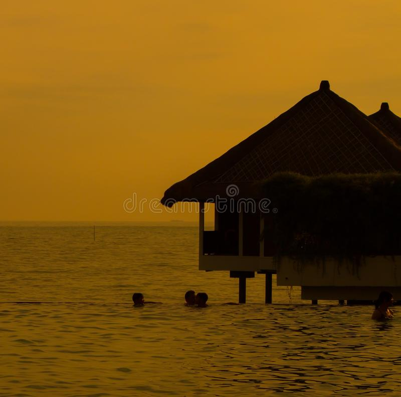 Holiday water chalets. During sunset royalty free stock image