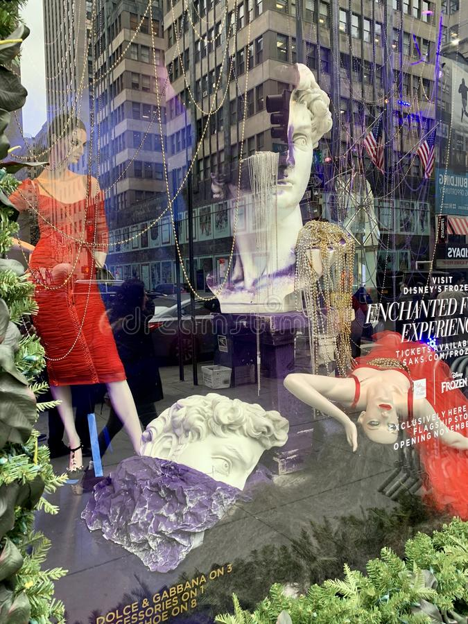 Holiday window display at Saks Fifth Avenue in NYC. royalty free stock photo