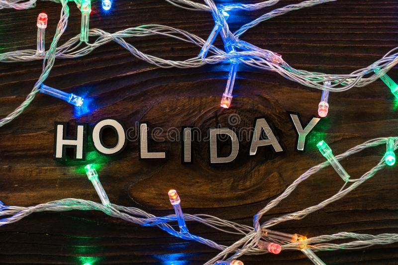 Holiday word with led lamp garland royalty free stock images