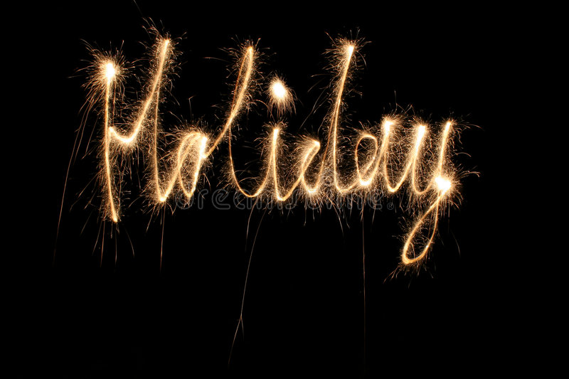 Holiday word sparkler stock photography