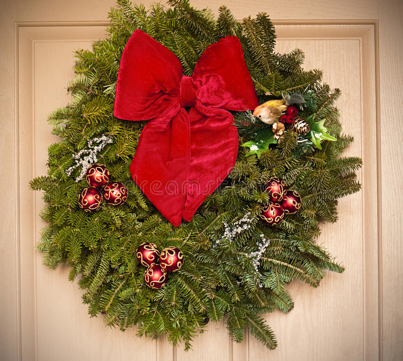 Download Holiday Wreath Hanging On A Door Stock Image - Image: 12328689