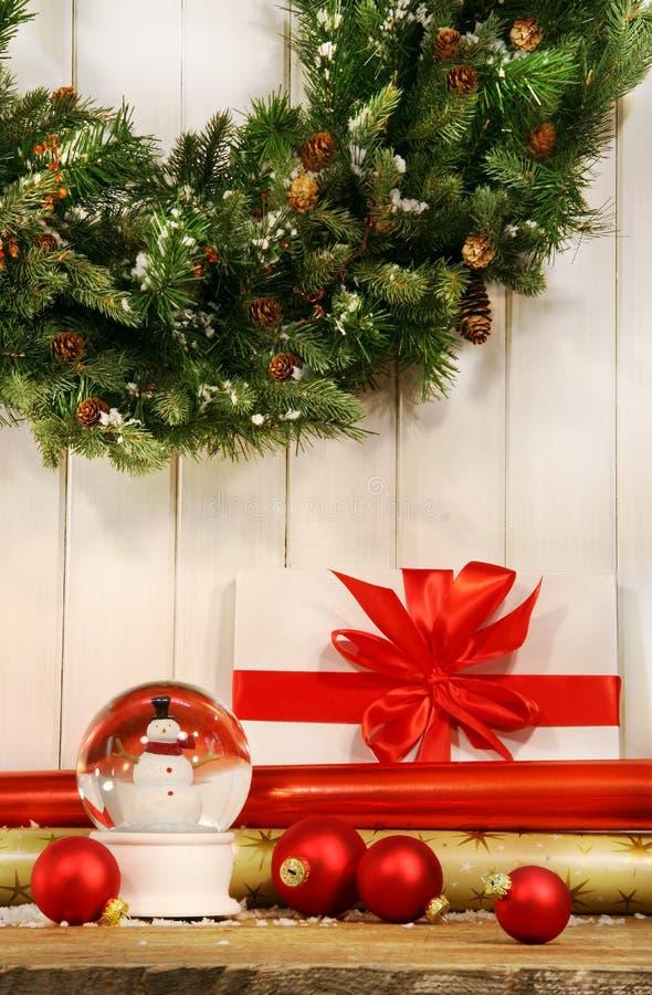Holiday wreath with snow globe stock photos