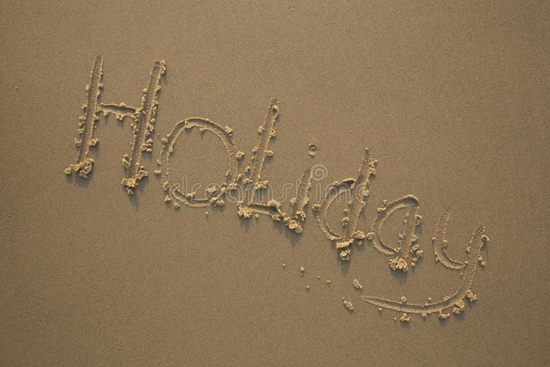 Holiday Written In The Sand Stock Photo - Image of good ...