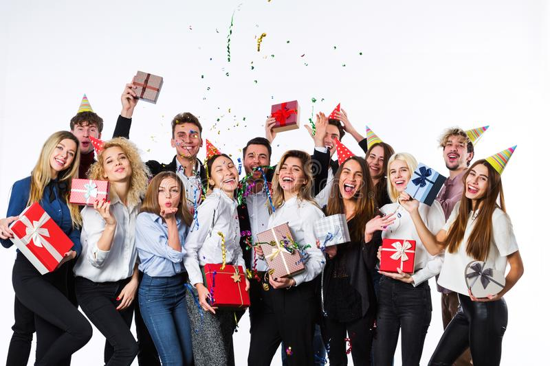 Holiday. Young beautiful people having fun on a white background. Concept celebrating birthday stock photos