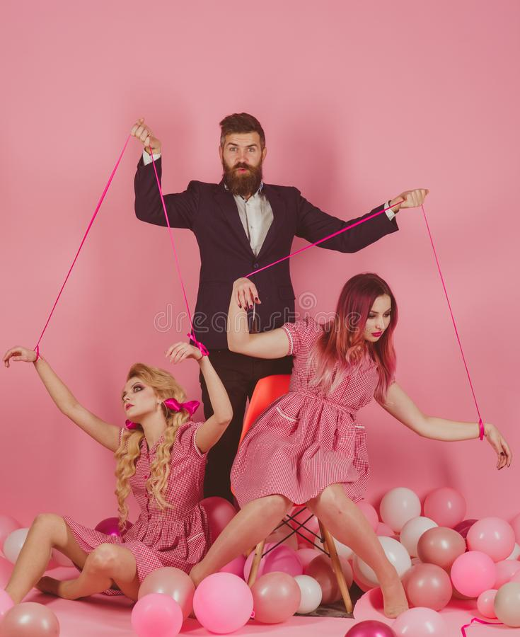 Free Holidays And Dolls. Dominance And Dependence. Creative Idea. Love Triangle. Retro Girls And Master In Party Balloons Stock Photos - 132830973