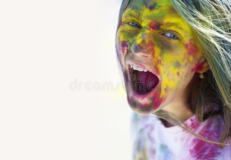 Holidays camp. Happy life in teenager time. Copy space. Emotional girl with happy mood with colorful drycolors. Colorful. Holi on painted hair. Camp and royalty free stock images