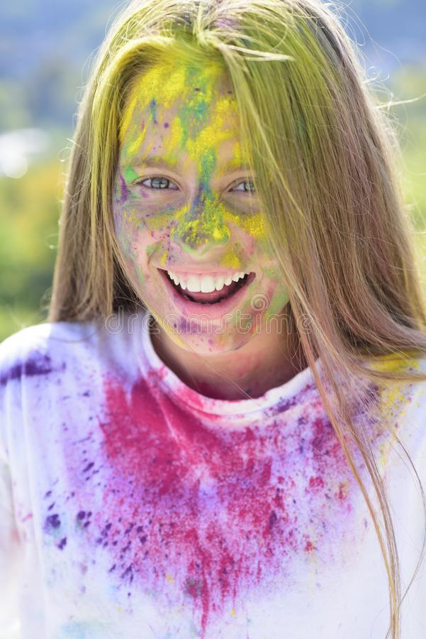 Holidays camp. Happy life in teenager time. Emotional girl with happy mood with colorful drycolors. Colorful holi on. Painted hair. Camp and carefree pastime stock photo