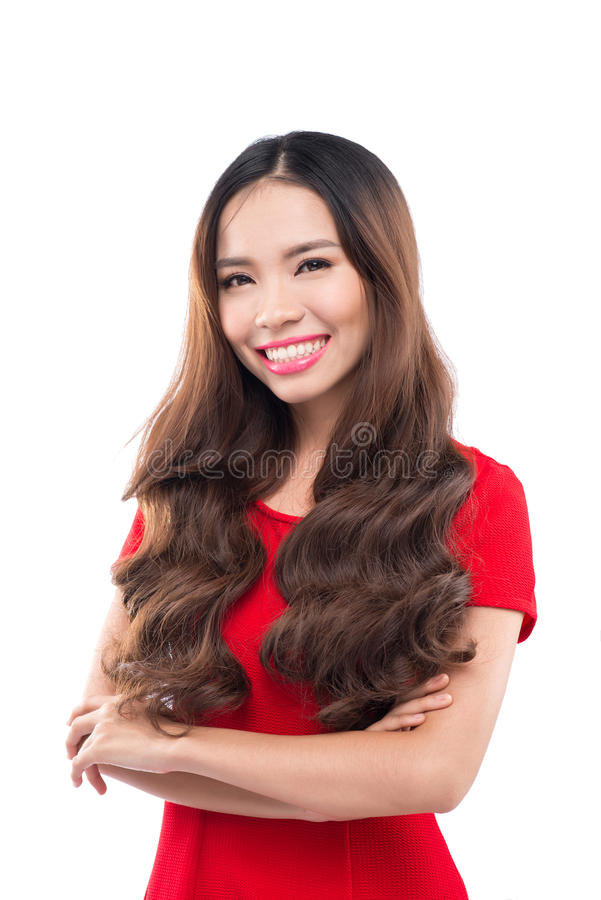 Holidays, celebration and people concept - smiling woman in red dress on white background royalty free stock images