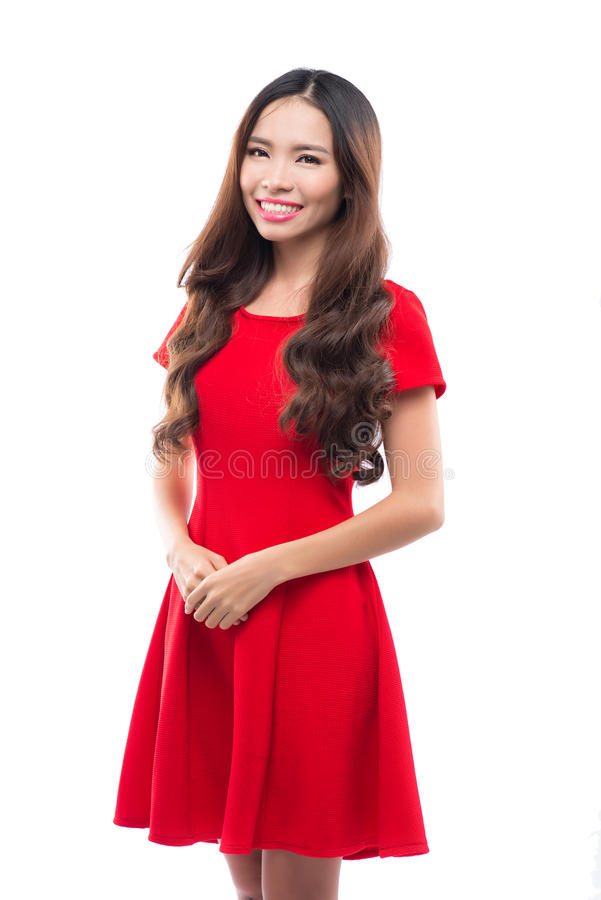 Holidays, celebration and people concept - smiling woman in red dress on white background stock images