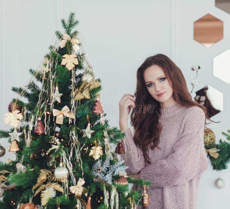 Woman standing in christmas interior background royalty free stock photos