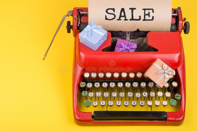 Holidays concept - red typewriter with craft paper with text stock photos