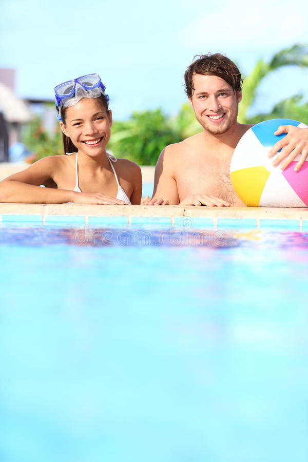 Holidays couple in pool stock photography