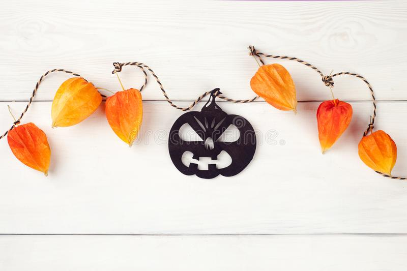 Holidays, decoration and party concept - happy halloween festive garland with black pumpkin. Holidays, decoration and party concept - happy halloween festive stock photos