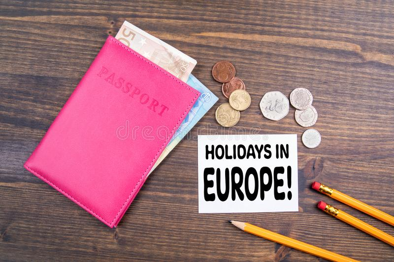 Holidays in Europe. Euro money and British coins with passport royalty free stock images
