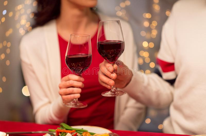 Close up of couple drinking red wine on christmas royalty free stock image