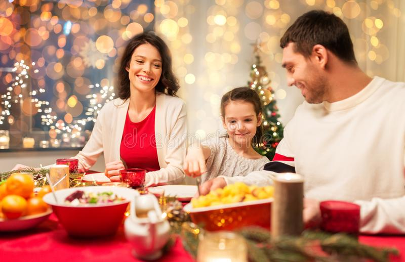 Happy family having christmas dinner at home stock image