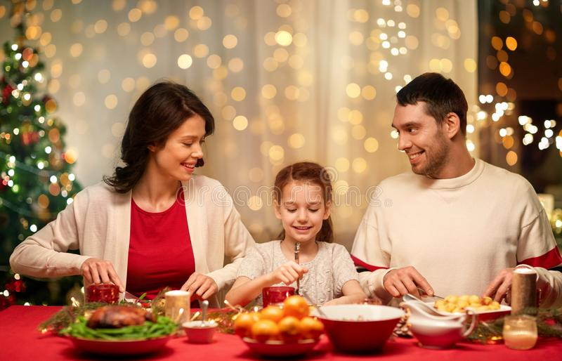 Happy family having christmas dinner at home royalty free stock photography