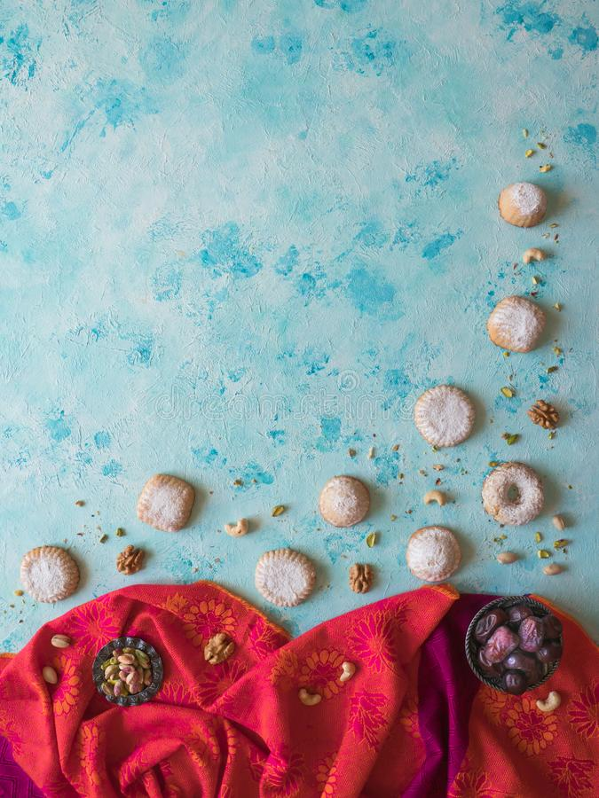 Holidays food background. Arab sweets are laid out on a blue table.  stock photo