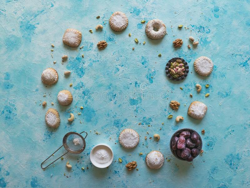 Holidays food background. Arab sweets are laid out on a blue table.  royalty free stock image
