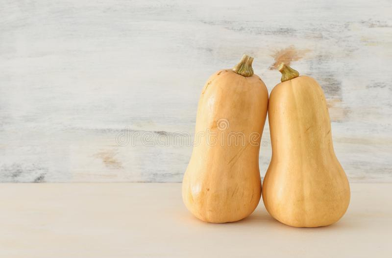 Holidays Halloween image. pumpkin over wooden white table stock image