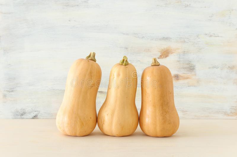 Holidays Halloween image. pumpkin over wooden white table royalty free stock photo