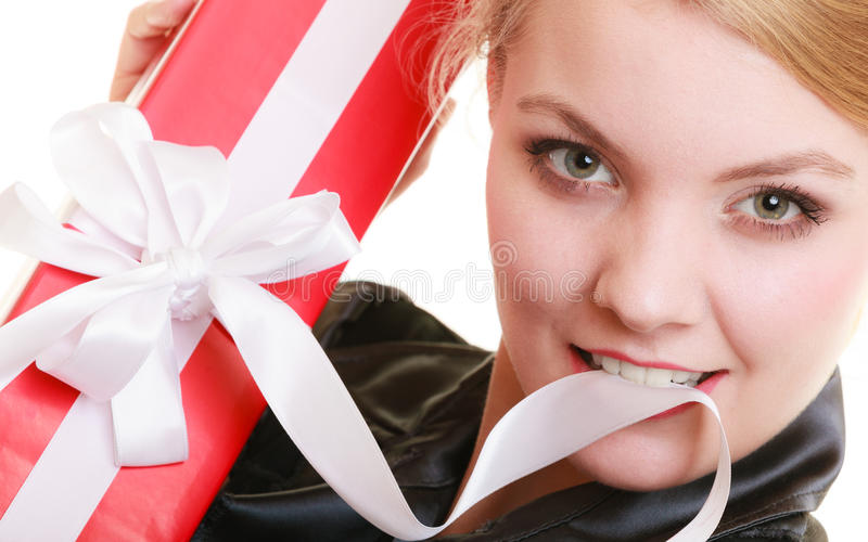 Holidays love happiness concept - girl with gift box. Holidays love and happiness concept - beautiful blonde girl with red gift box isolated stock photo