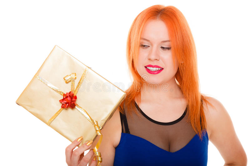 Holidays love happiness concept - girl with gift box. Christmas x-mas winter or valentine's day, birthday concept - red hair girl holding golden gift box studio royalty free stock photography