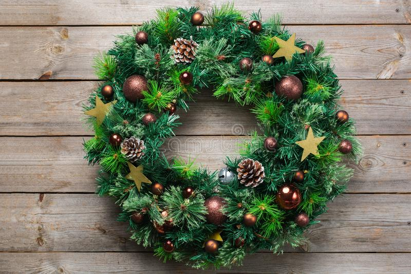 Advent christmas wooden door wreath with festive decoration royalty free stock image