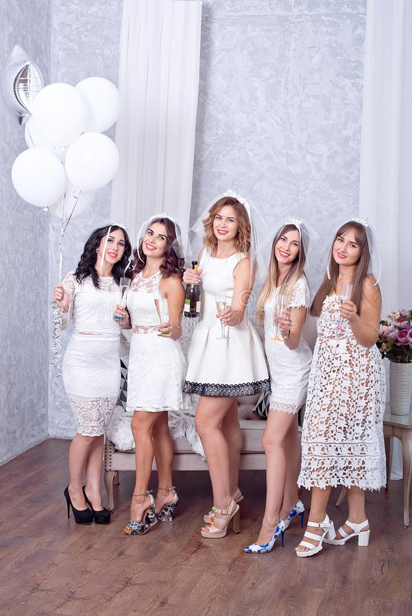 Holidays, nightlife, bachelorette party and people concept - smiling women with champagne glasses.  royalty free stock images