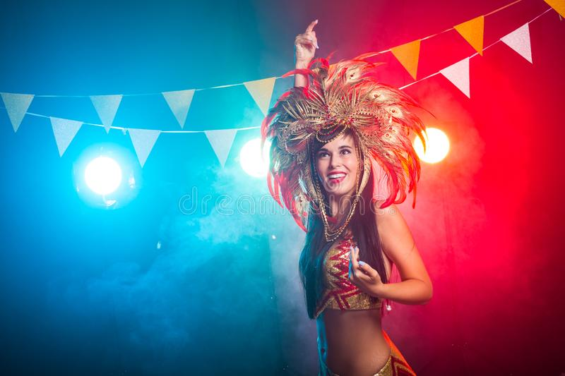 Holidays, party, dance and nightlife concept - Beautiful woman dressed for carnival night royalty free stock photo