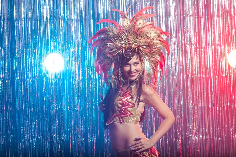 Holidays, party, dance and nightlife concept - Beautiful woman dressed for carnival night stock image
