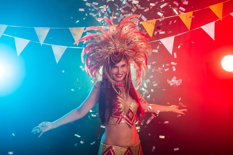 Holidays, party, dance and nightlife concept - Beautiful woman dressed for carnival night royalty free stock image