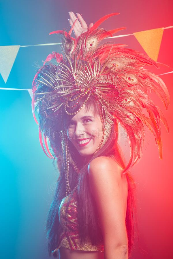 Holidays, party, dance and nightlife concept - Beautiful woman dressed for carnival night stock photo