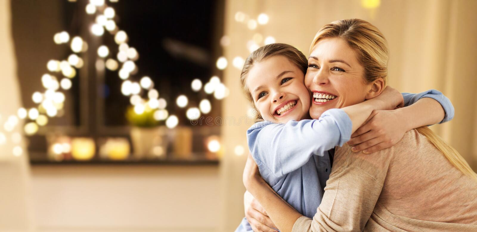 Happy smiling family hugging at home on christmas royalty free stock photo