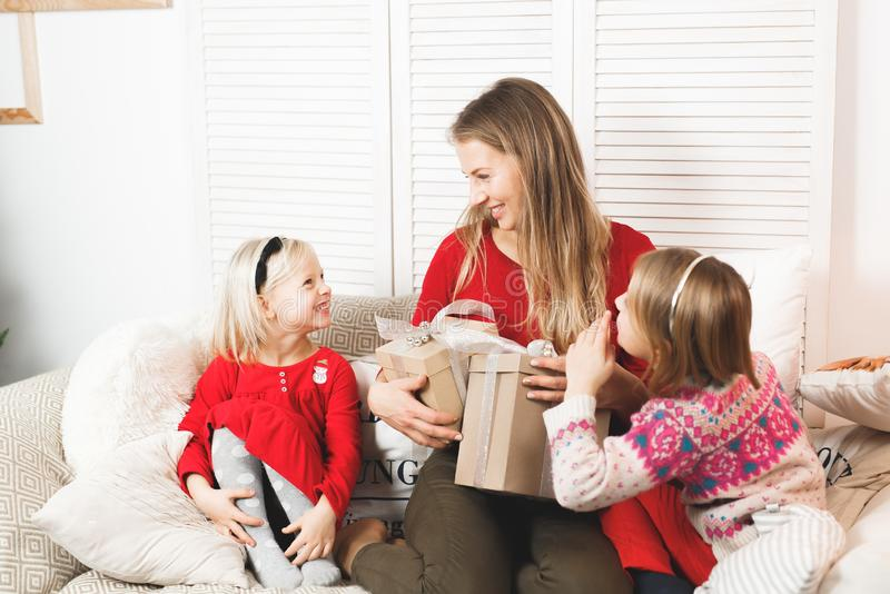 Holidays, presents, christmas, x-mas, birthday concept - happy mother and child girl with gift box stock photo
