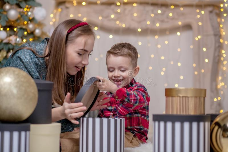 Holidays and presents concept - Close-up of family opening gifts at Christmas time royalty free stock images