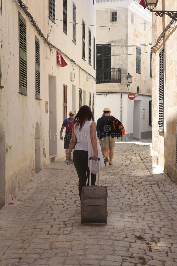 Holidays rental users walking downtown ciutadella in minorca vertical royalty free stock images