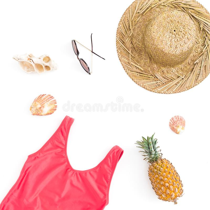 Holidays summer concept. Frame of pineapple fruit, sun glasses, straw hat and pink swimwear on white background. Flat lay, top vie royalty free stock photos
