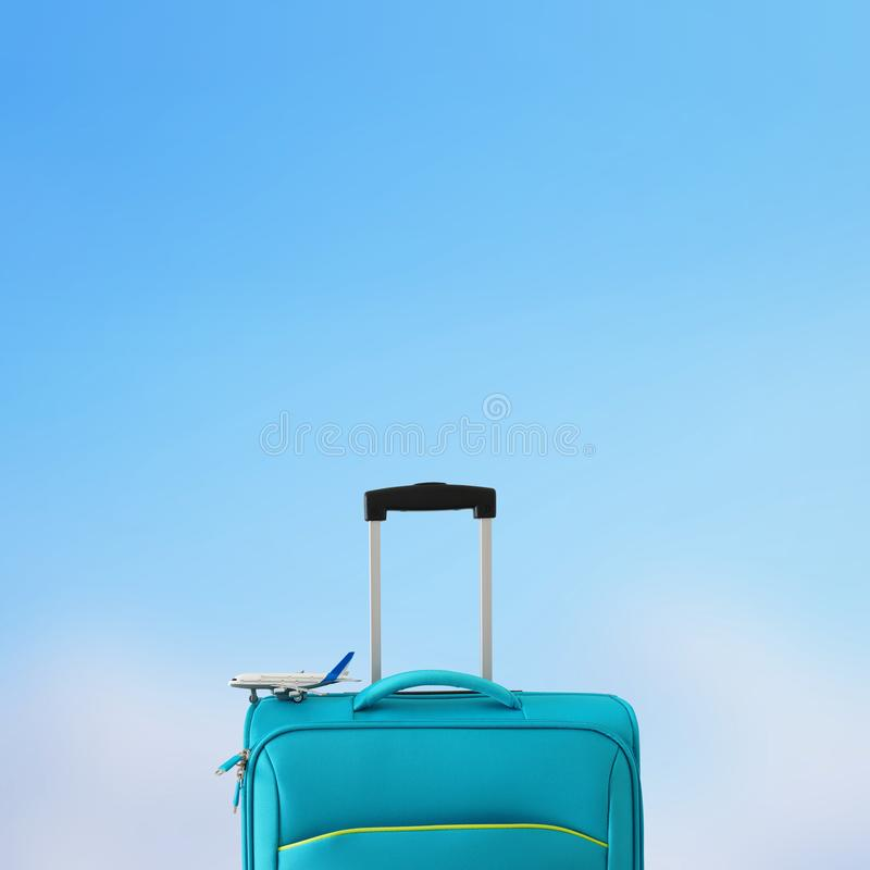 Holidays. travel concept. blue suitcase and airplane toy infront of bokeh blue background.  stock images