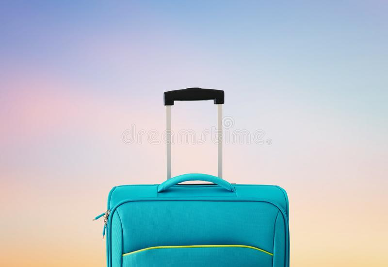 Holidays. travel concept. blue suitcase infront of bokeh background.  royalty free stock image