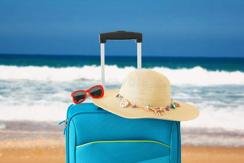 Holidays. travel concept. blue suitcase infront of tropical background.  stock photos