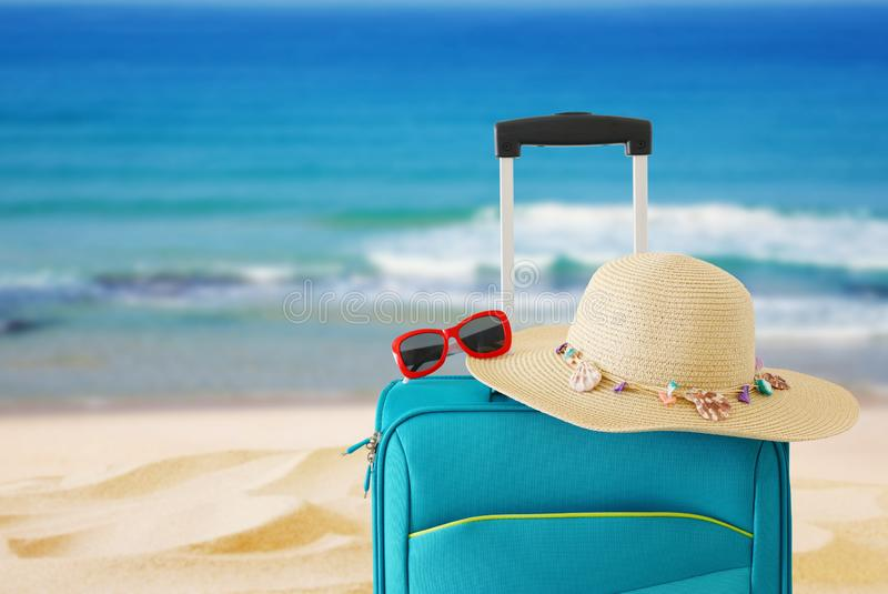 Holidays. travel concept. blue suitcase infront of tropical background.  royalty free stock photography