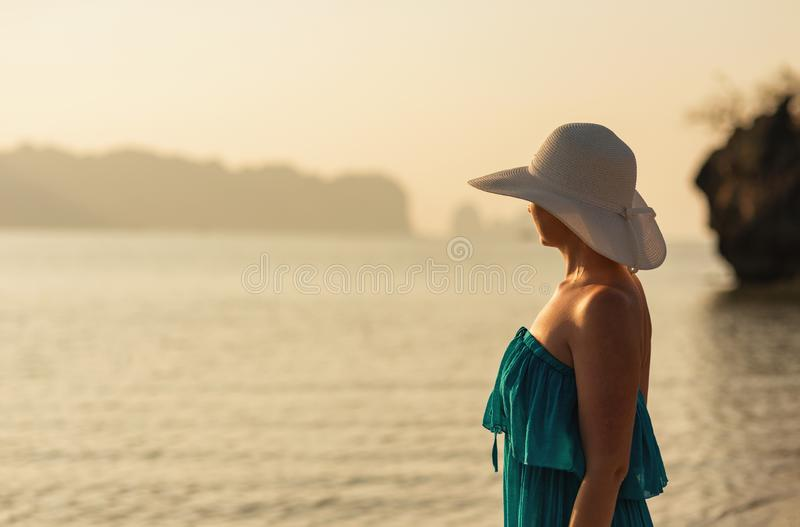 Holidays in tropics, woman at susnet on coast royalty free stock photo