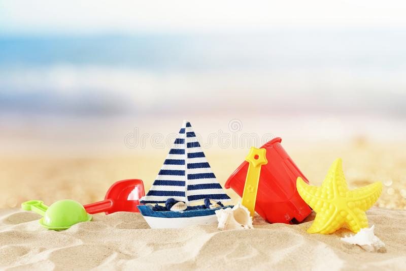 Holidays. vacation and summer image with beach colorful toys for kid over the sand.  stock photo