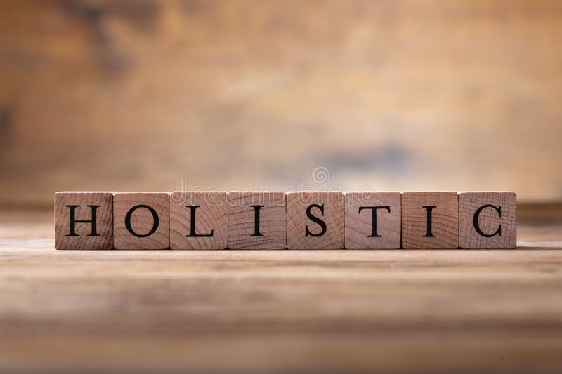 Holistic Wooden Blocks. Photo Of Holistic Wooden Blocks On Wooden Desk royalty free stock photo